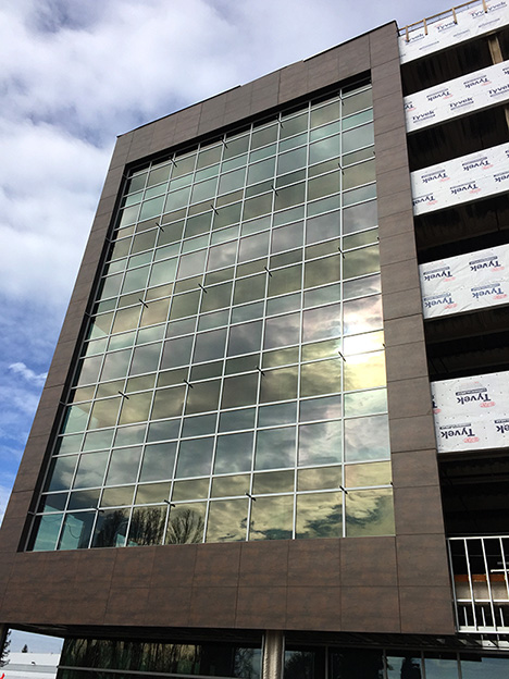 SLTC Phase 1 neolith exterior cladding and View Dynamic Glass